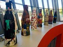 Artistically designed Coca-Cola bottles. Royalty Free Stock Photo
