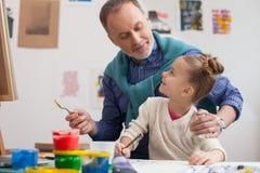 Artistique s'avère dans la famille des peintres Image stock