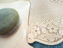Artistry with leather, making a new saddle. Intricate details in the art of saddle making royalty free stock photography