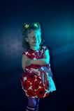 Artistry of a little girl on a black background close-up. The artistic child on the stage in a beautiful dress stock photo