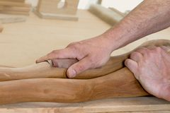 Artistry wood polish. A Carpenter is polishing an artistry piece of wood stock photography