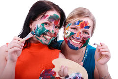 Artists. Portrait of two young girls with the painted face on a white background Stock Image