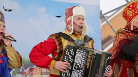 Artists with an accordion singing on stage in winter stock footage
