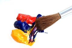 Artists brush. Art brush and paints primary colours stock images