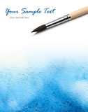 Artists brush and watercolor paint stock photos