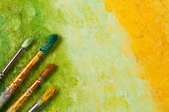 Artists brushes on artistic background Royalty Free Stock Images