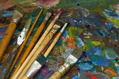 Artists brushes and oil paints on palette. Brushes and oil paints on palette Royalty Free Stock Image