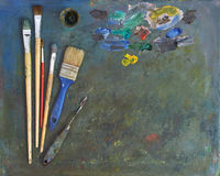 Artists brushes and oil paints. Palette with paintbrush and palette-knife Royalty Free Stock Photo