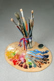 Artists Brushes and Palette. Artist's Brushes with palette in the foreground stock photos