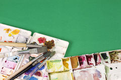 Artists brushes and watercolor paints Stock Image