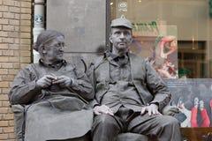 Artists depict old couple during world championships living statues in Arnhem. Arnhem, Netherlands - September 28, 2014: artists depict old couple during world stock image