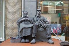 Artists depict old couple during world championships living statues in Arnhem. Arnhem, Netherlands - September 28, 2014: artists depict old couple during world stock photography