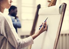 Artists drawing in art class royalty free stock image