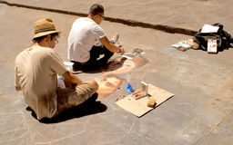 Artists drawing on pavement Royalty Free Stock Photo