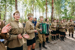 Artists dressed as Soviet Russian soldiers dance Royalty Free Stock Images