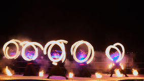 Artists juggling with burning poi's at fire performance. Stock Images