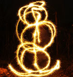 Artists juggling with two flaming poi's on fire. Prolonged exposure causes painting with light. Stock Image