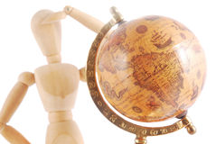 Artists mannequin with globe. Artists mannequin with antique globe isolated on white background stock images