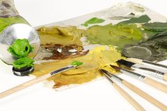 Artists materials. Artists brushes pallette and oil paint on a white background Stock Image