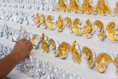 Artists. Modeller painted gold on frescoes. Art by skilled artists Stock Photo