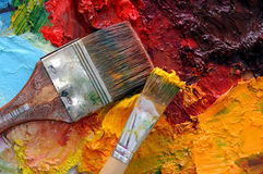 Artists oil painting palette. Artists oil paints and brush multi coloured close up semi abstract Stock Photography