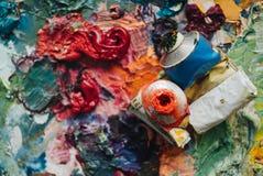 Artists oil paints on wooden palette. stock photos