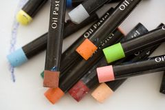Oil Pastels. Artists oil pastels on a white canvas background with copy space Royalty Free Stock Image