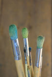 Artists paint brushes close up. A set of artitst's brushes with soft focus background royalty free stock photography