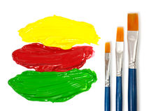 Artists paint brushes and three color of paint Royalty Free Stock Photos