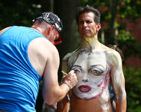 Artists paint 100 fully nude models of all shapes and sizes during 4th NYC Body Painting Day. NEW YORK - JULY 22, 2017: Artists paint 100 fully nude models of Royalty Free Stock Photos