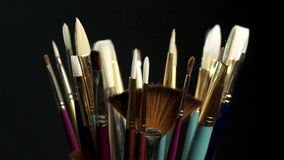 Artists paintbrushes stock video footage