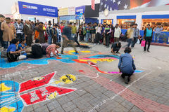 Artists painting floor at Kolkata International book fair - 2015. Stock Images