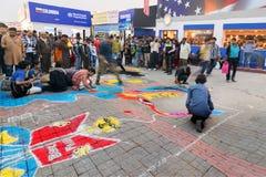 Artists painting floor at Kolkata International book fair - 2015. Stock Images
