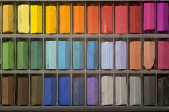 Artists pastels. Multi coloured artists pastel crayons pattern close up Stock Photos