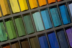 Artists pastels. Multi coloured artists pastel crayons pattern close up Stock Photography