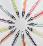 Artists pencils colouring gel pens nibs art drawing. Photo of various coloured artists gel pens pencils arranged in a circle on white background stock photos