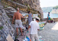 Artists on the promenade of Budva, Montenegro stock images