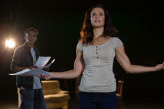 Artists rehearsing on stage. In theatre stock photos