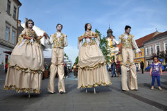 Artists on stilts performing in medieval costumes Royalty Free Stock Image