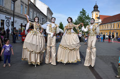 Artists on stilts performing in medieval costumes Royalty Free Stock Photos