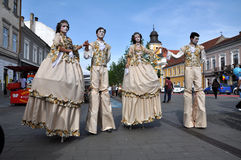 Artists on stilts performing in medieval costumes Stock Photography