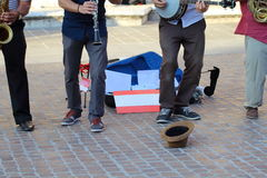 Artists in the street. Music in the street, artists and musicians united in the love of the show Stock Image