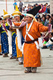Artists in Tibetan clothes performing folk dance Stock Photography