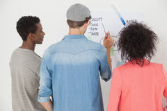 Artists using whiteboard in creative office Royalty Free Stock Photo