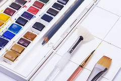 Artists watercolour paints and paint brush Royalty Free Stock Images