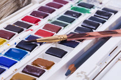 Artists watercolour paints and paint brush Stock Images
