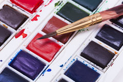 Artists watercolour paints and paint brush Royalty Free Stock Photography