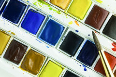 Artists watercolour paints and paint brush. Artists watercolour paints and sable hair paint brush background hobbies and leisure time Royalty Free Stock Images