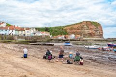 Artists at Work, Staithes, Yorkshire, England. royalty free stock images