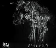 Artitic black and white view of burning incense cones with intense smoke Royalty Free Stock Photos